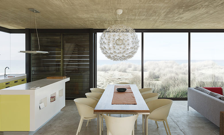 Dining room and kitchen overlooking ocean