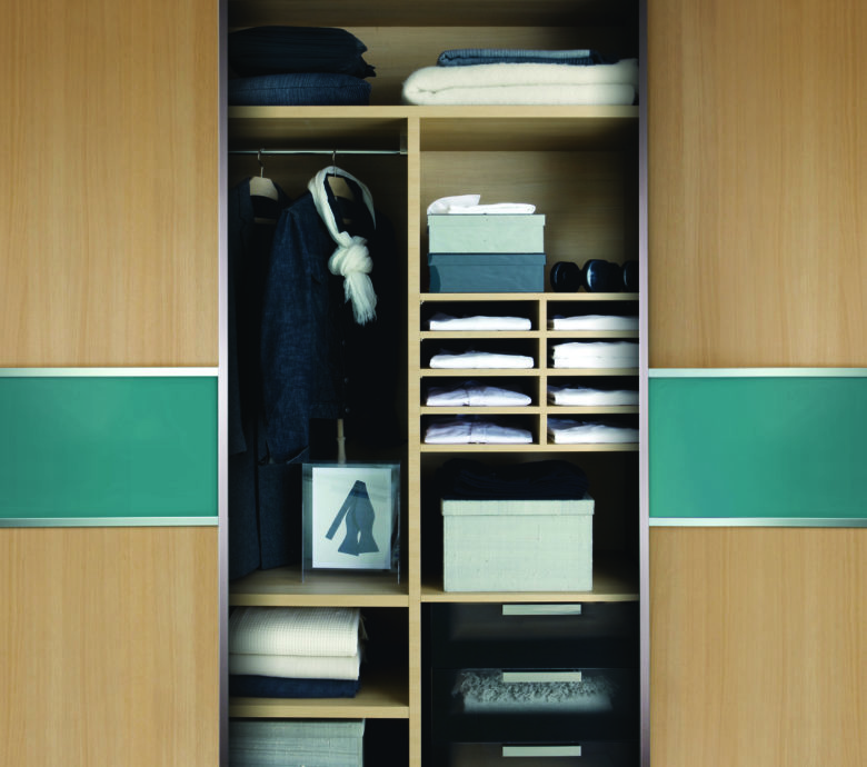 Minimal wardrobe with few clothes in it